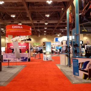 Aisle of the PDAC with exhibitors from different country like China